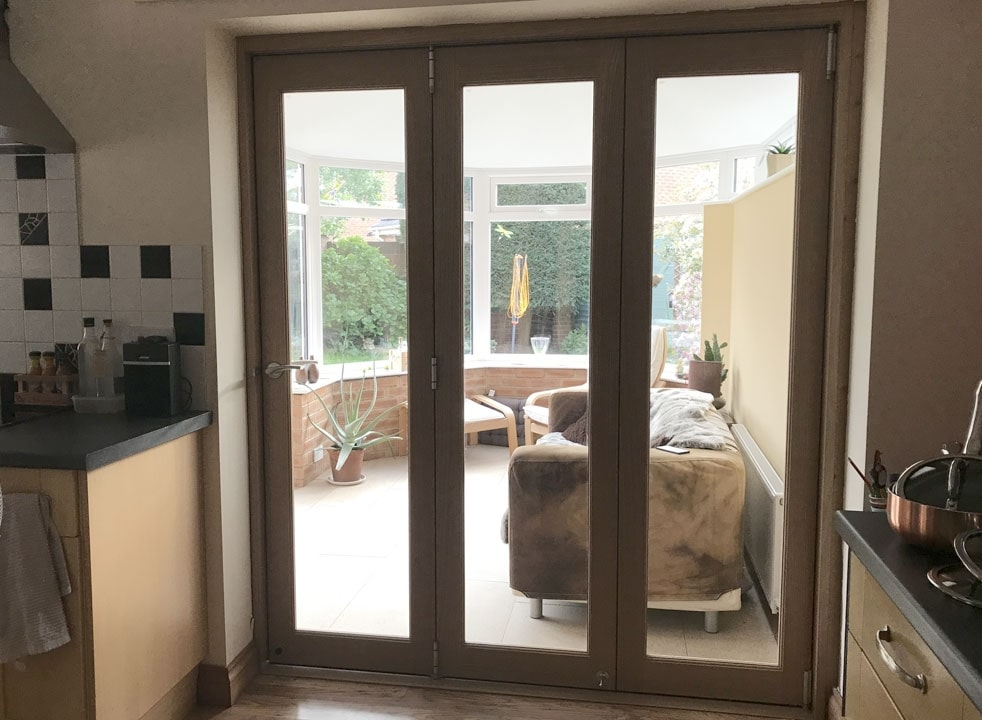 Closed Finesse 1.8M Internal bifold doors looking into the conservatory