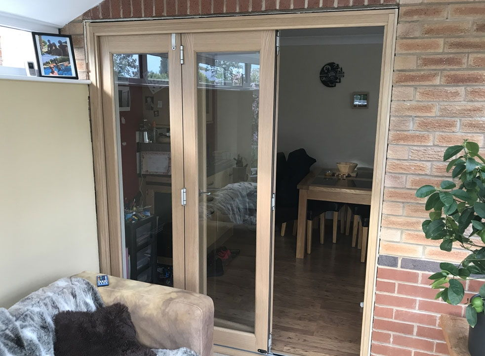 Access door open on a set of Finesse 1.8M Internal bifold doors