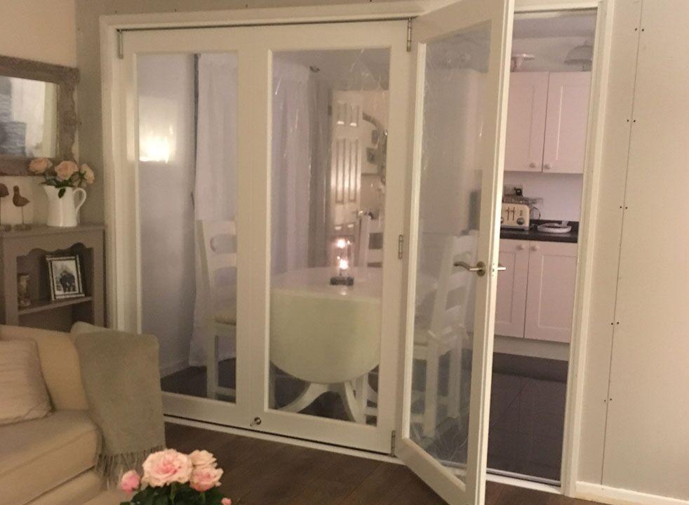 Access door open on a Finesse white internal bifold door