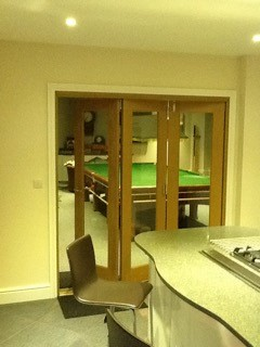 Finesse 1.8M Internal Bifold Door connects pool room