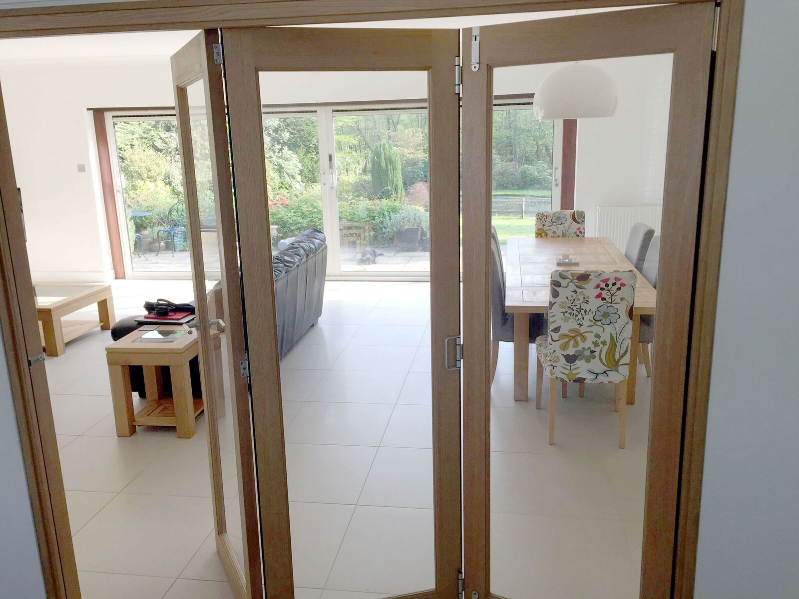 Finesse 2.1M Internal Bifold Doors connects the kitchen with lounge