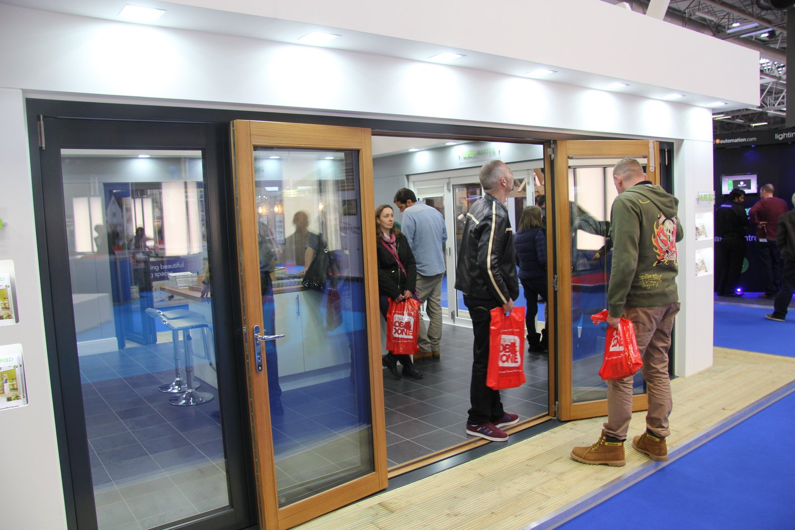 Visitor Looking at the Ultra Bifolding Door top roller system