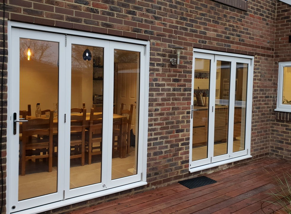 2 sets of Master White timber 1.8M bifold doors