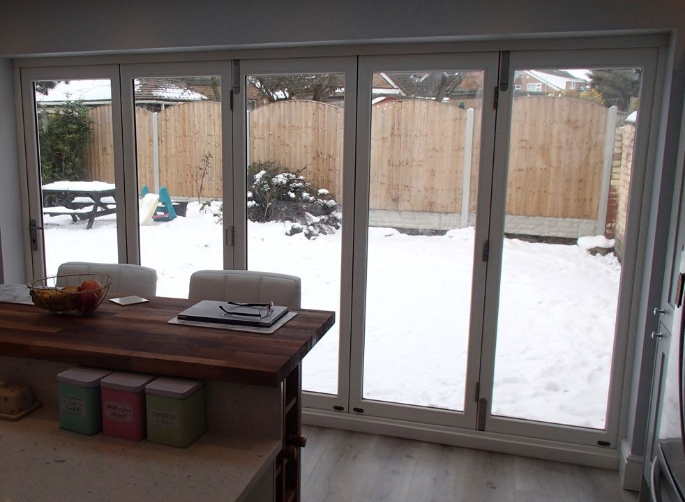 Master White 3.6M Bifold door closed looking on to the garden