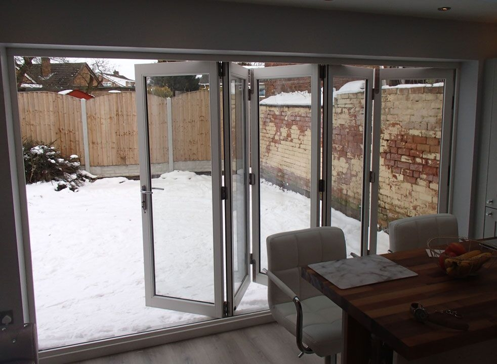 Master White 3.6M Bifold door opening to the garden