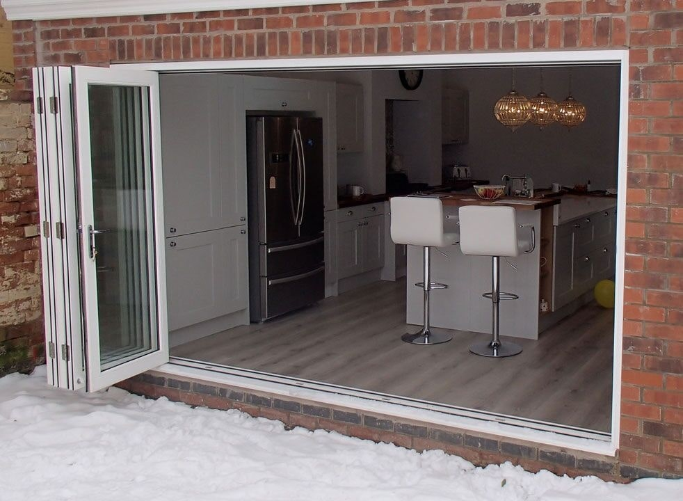 Master White 3.6M Bifold door open into the kitchen