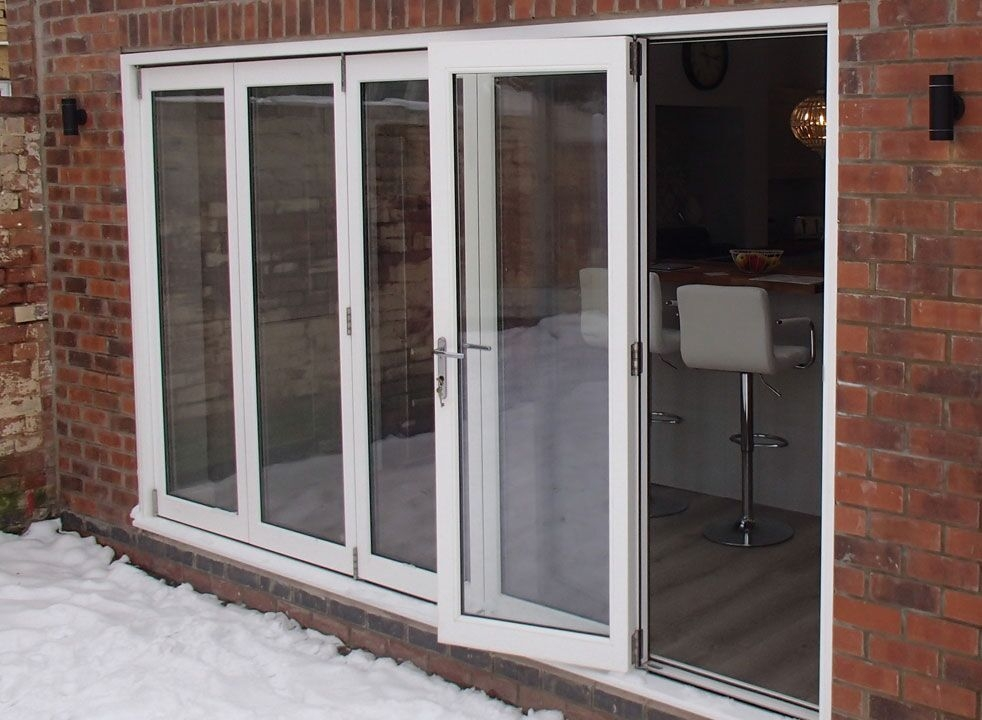 Master White 3.6M Bifold door - access door open looking into the kitchen