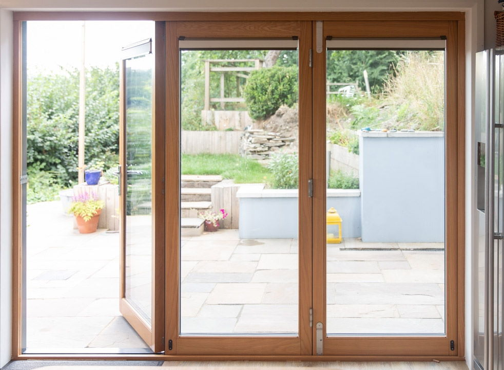 Inside view of a 2.7M Ultra grey bifold door with the access door open