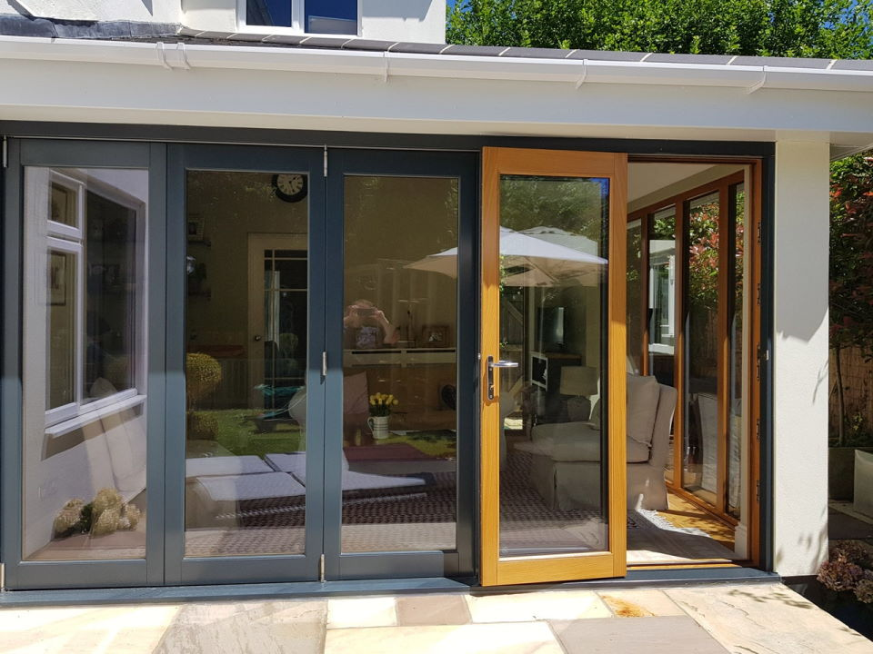 Outside view with access door open - Ultra Grey 3.6M Bifold doors