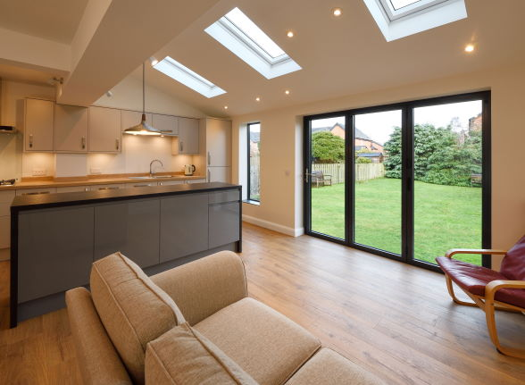 Closed Status Aluminium grey bifold doors looking out to garden