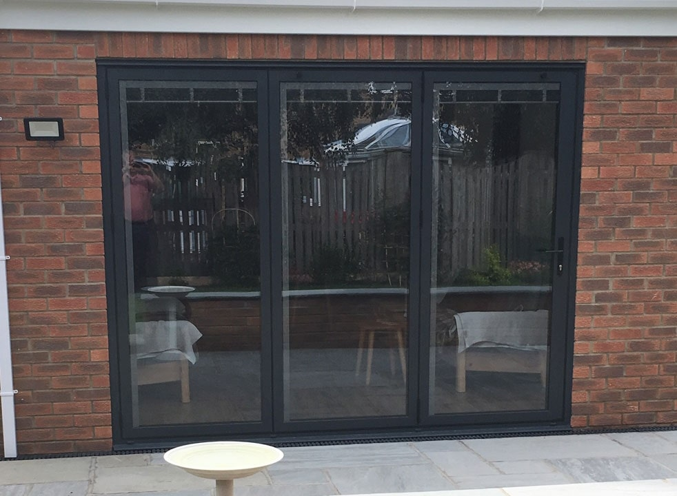 Bespoke outside view of a closed Status Aluminium Bifold doors