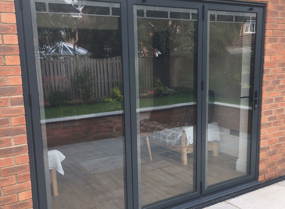 Bespoke outside side view of a closed Status Aluminium Bifold doors