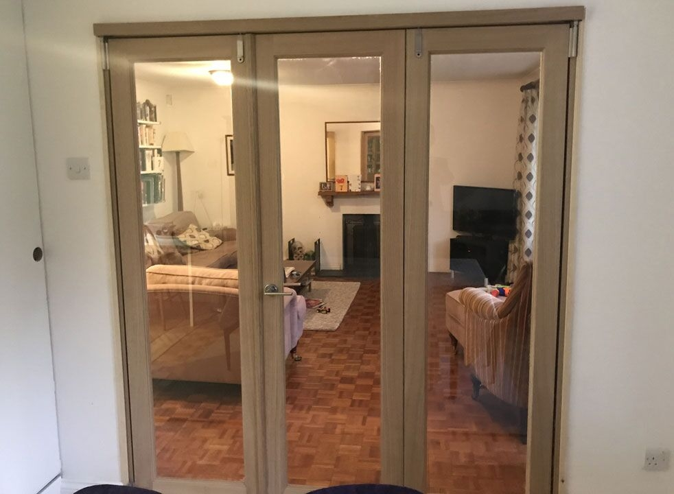 Inspire 1.8M internal bifold doors divides the dining room and lounge