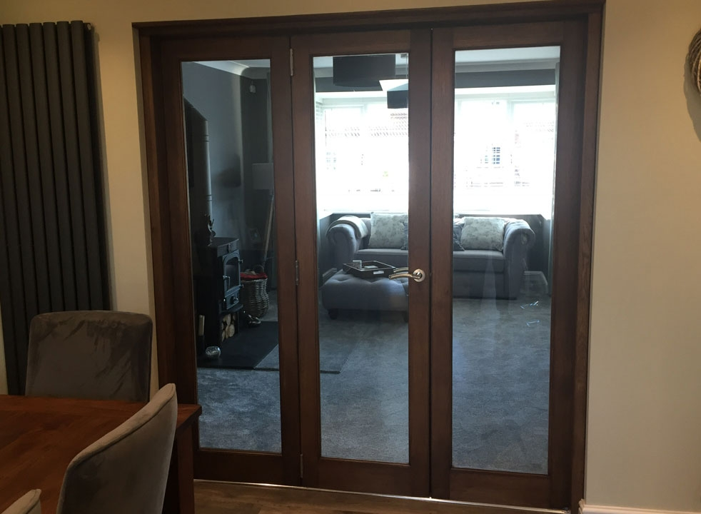 Dark stained Closed Inspire Internal Bifold doors from the dining room
