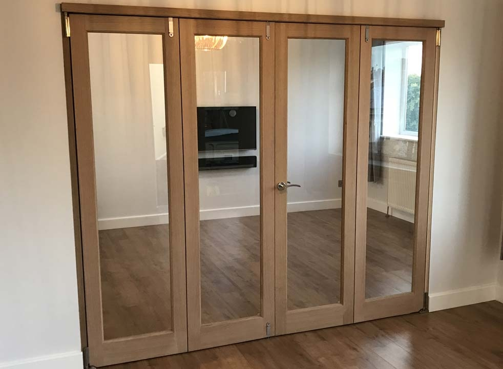 Closed 2.4M Inspire internal bifold doors perfeclty intersect 2 rooms