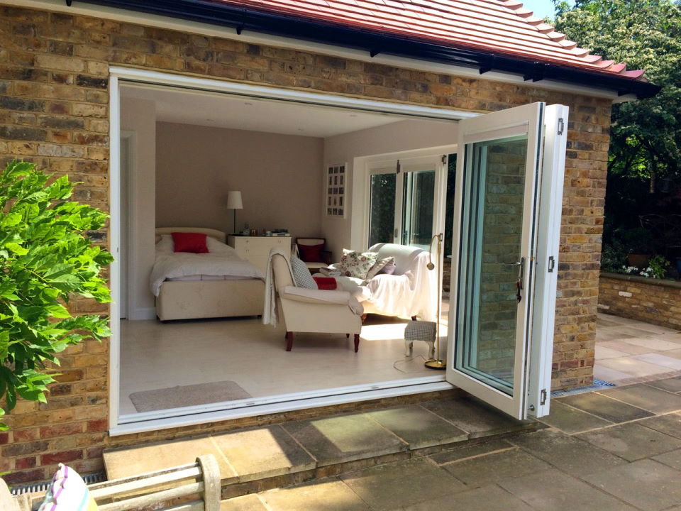 Open 9ft bifold doors looking into the bedroom-cum-lounge