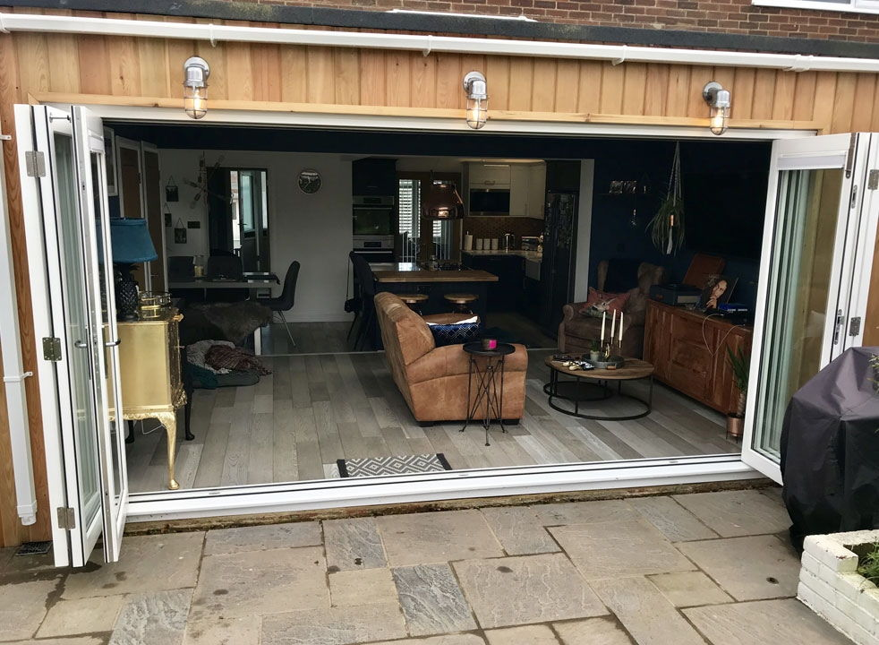 Master White 4.2M timber bifold doors open from the outside