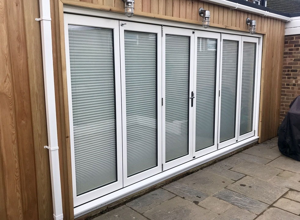 Master White 4.2M Closed timber bifold doors with blinds closed