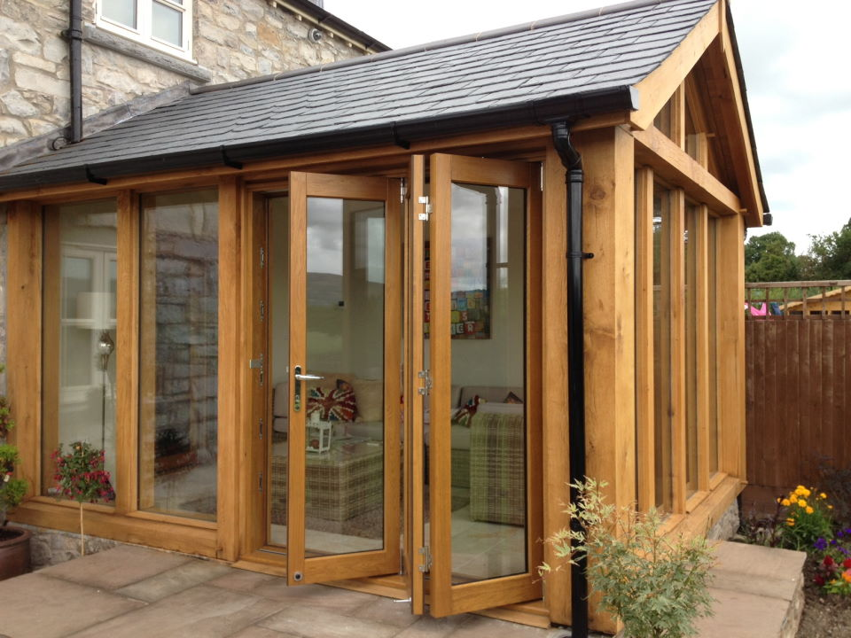 Diy conservatories with bifold doors for Conservatory doors exterior