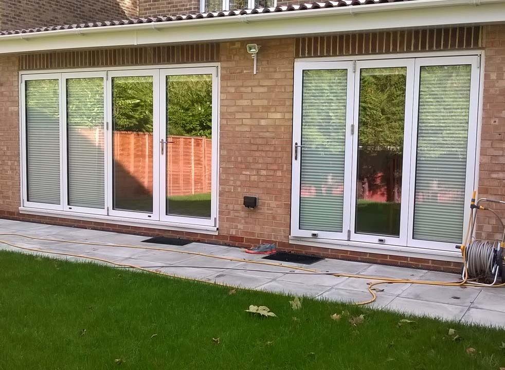Outside view - Supreme 3.6M & 2.1M White Aluminium bifold doors