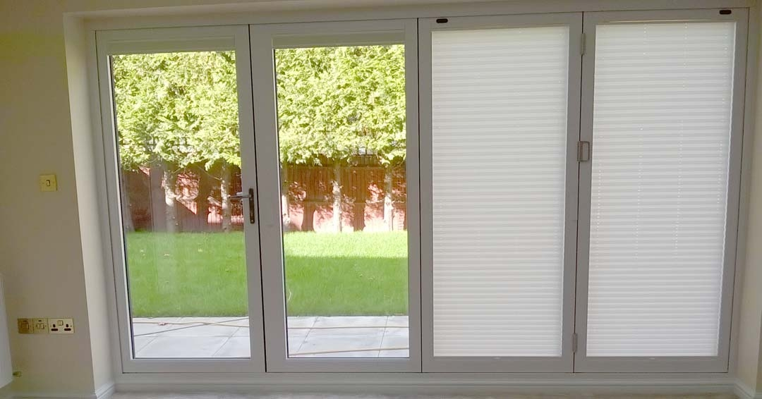 Inside view with half the blinds shut - Supreme 3.6M White Aluminium bifold doors