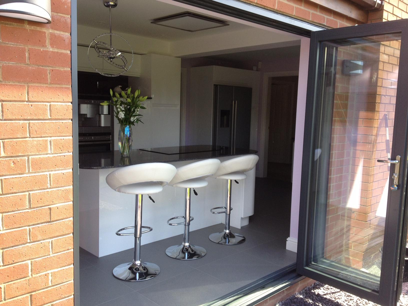 Outside open 8ft Supreme Aluminium Bifold Doors