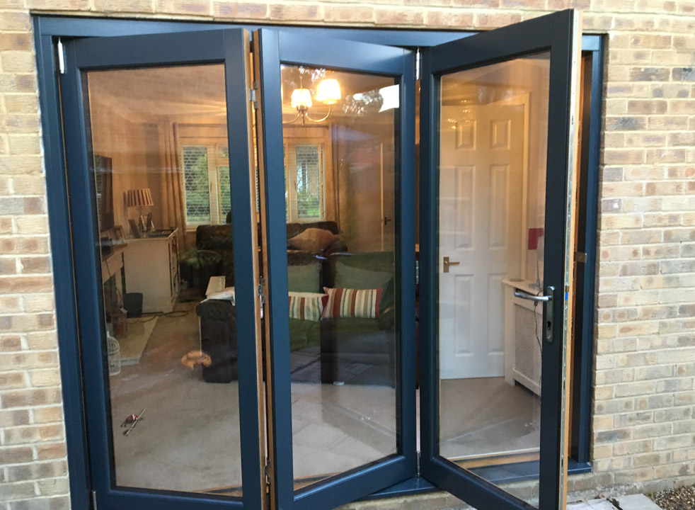Outside partially open 2.4M Grey External Bifold Door set