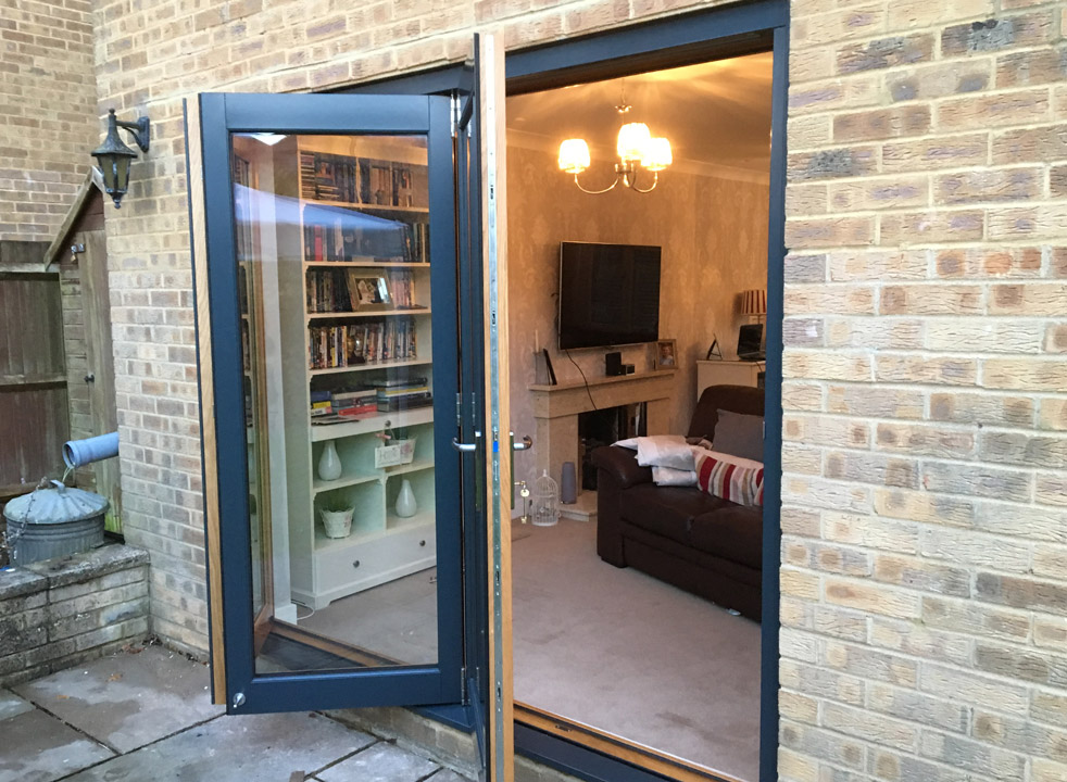 Access doors open on a 2.4M Grey External Bifold Door set