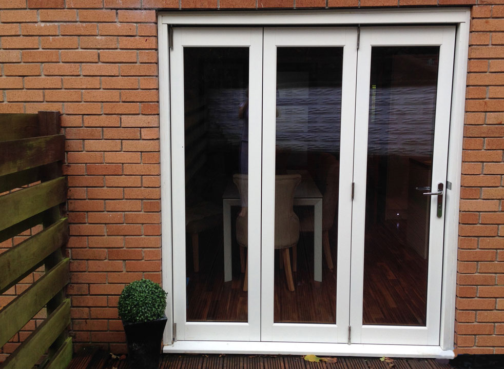 Outside, closed 1.8M Ultra white extrenal bifold doors